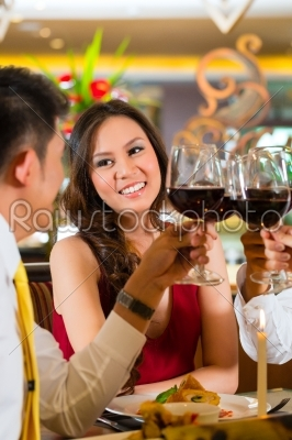 stock photo: chinese couples toasting with wine in restaurant-Raw Stock Photo ID: 49547