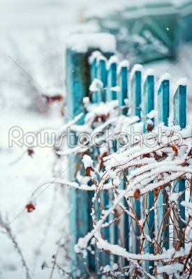 stock photo: close up of a winter fence with grass-Raw Stock Photo ID: 68290