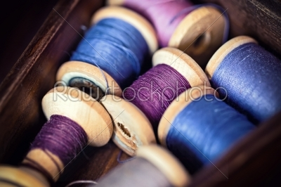 stock photo: collection of blue spools threads  arranged in a grunge wooden box-Raw Stock Photo ID: 68351