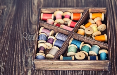 stock photo: collection of different color spools  threads  arranged in a grunge wooden box-Raw Stock Photo ID: 68353