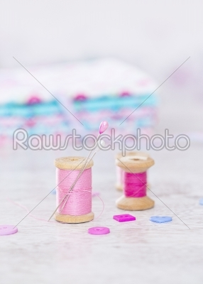 stock photo: collection of spools  threads in pink colors arranged on a white wooden background-Raw Stock Photo ID: 68477