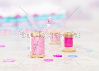 stock photo: collection of spools  threads in pink colors arranged on a white wooden background-Raw Stock Photo ID: 68478