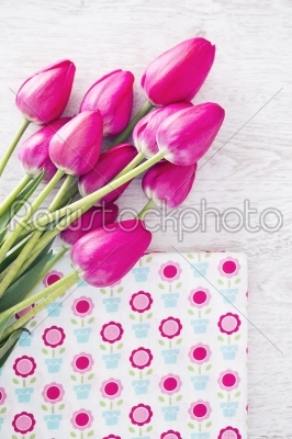 stock photo: collection of spools  threads in pink colors arranged on a white wooden background with tulips-Raw Stock Photo ID: 68476