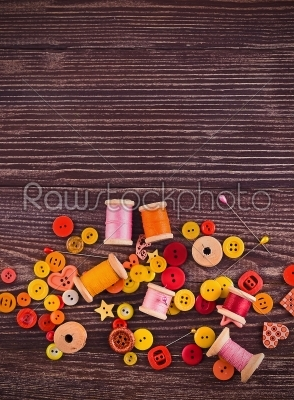 stock photo: collection of spools  threads in yellowred colors arranged on a grunge wooden box-Raw Stock Photo ID: 68355
