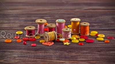 stock photo: collection of spools  threads in yellowred colors arranged on a grunge wooden box-Raw Stock Photo ID: 68357