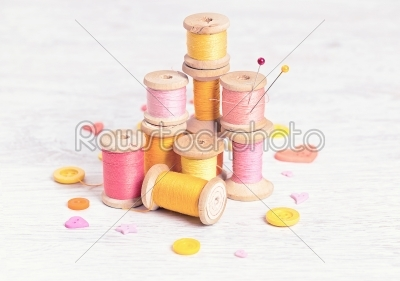 stock photo: collection of spools  threads in yellowred colors arranged on a white wooden background-Raw Stock Photo ID: 68033