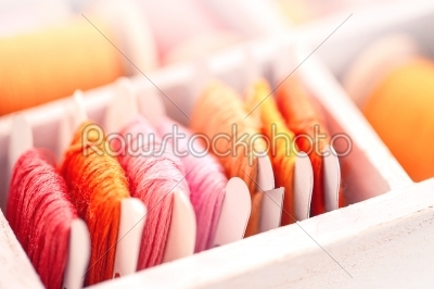 stock photo: collection of yellow red pink  threads  arranged in a white wooden box-Raw Stock Photo ID: 68384