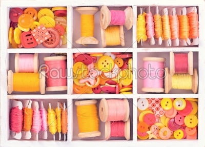 stock photo: collection of yellow red pink spools  threads  arranged in a white wooden box-Raw Stock Photo ID: 68032
