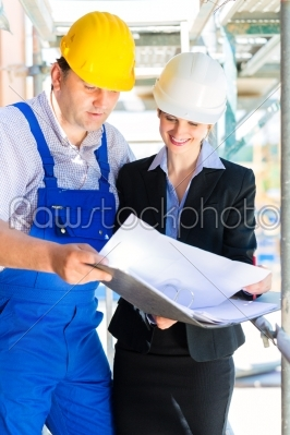 stock photo: construction team with building plans on site-Raw Stock Photo ID: 49494