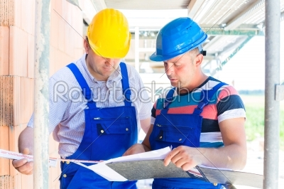 stock photo: construction team with building plans on site-Raw Stock Photo ID: 49496