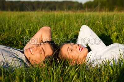 stock photo: couple sleeping on meadow in the sunshine-Raw Stock Photo ID: 50830