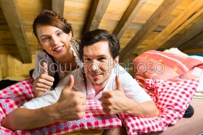 stock photo: couple with bed clothes in mountain cabin-Raw Stock Photo ID: 49707