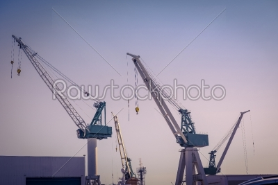 stock photo: cranes at a shipping harbor-Raw Stock Photo ID: 70228