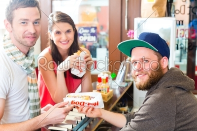stock photo: customers eating hotdog in fast food snack bar-Raw Stock Photo ID: 48714