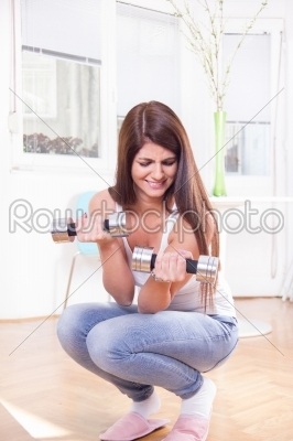 stock photo: cute girl exercise with dumbbells-Raw Stock Photo ID: 52711