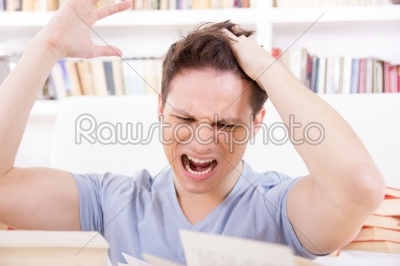 stock photo: dissatisfied and upset student with hand on his head-Raw Stock Photo ID: 52723