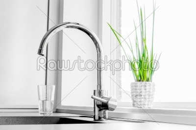 stock photo: faucet with a green plant-Raw Stock Photo ID: 66191
