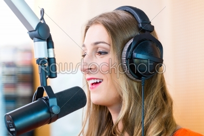 stock photo: female radio presenter in radio station on air-Raw Stock Photo ID: 49845