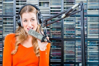 stock photo: female radio presenter in radio station on air-Raw Stock Photo ID: 49849