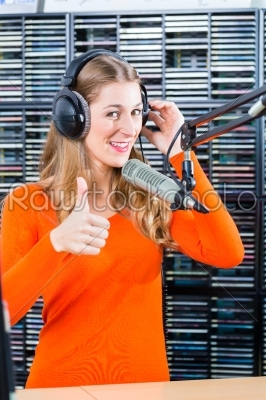 stock photo: female radio presenter in radio station on air-Raw Stock Photo ID: 49850
