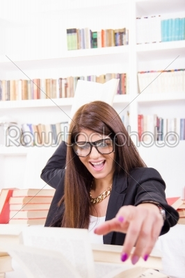 stock photo: female student throwing a book-Raw Stock Photo ID: 52780