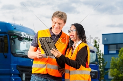 stock photo: forwarder in front of trucks on a depot-Raw Stock Photo ID: 49255