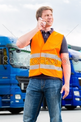 stock photo: forwarder in front of trucks on a depot-Raw Stock Photo ID: 49262