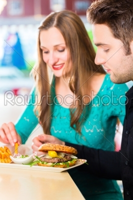 stock photo: friends or couple eating fast food with burger and fries -Raw Stock Photo ID: 48611