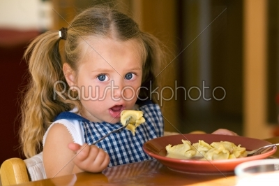 stock photo: girl eating pasta-Raw Stock Photo ID: 51369