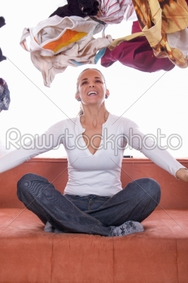 stock photo: girl tossing clothes-Raw Stock Photo ID: 53257