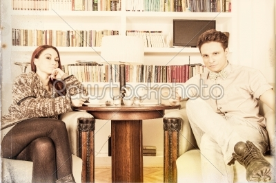 stock photo: glamor man and woman sitting on armchairs in the library-Raw Stock Photo ID: 53276