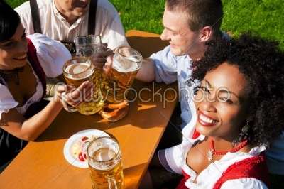 stock photo: group of four friends in beer garden eating and drinking-Raw Stock Photo ID: 51740
