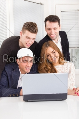 stock photo: group of friends and colleagues looking at laptop together-Raw Stock Photo ID: 53304