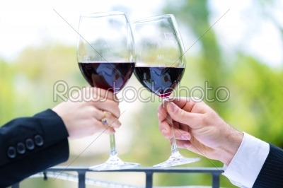 stock photo: hands holding red wine glasses to clink-Raw Stock Photo ID: 48553