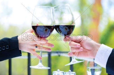 stock photo: hands holding red wine glasses to clink-Raw Stock Photo ID: 48555