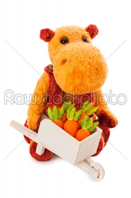 stock photo: isolated yellow hippo toy with the cart full of carrot-Raw Stock Photo ID: 68227