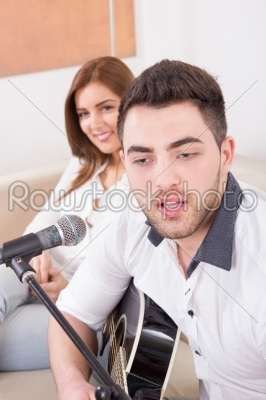 stock photo: man playing guitar to girl-Raw Stock Photo ID: 53740