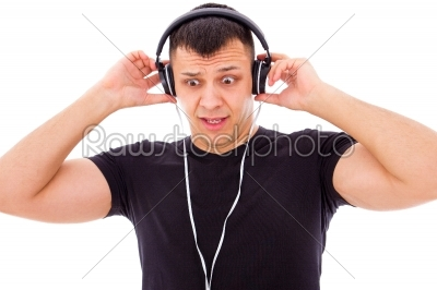 stock photo: man shocked by what he hears on headphones-Raw Stock Photo ID: 53768
