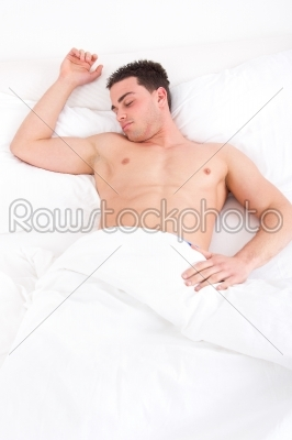 stock photo: man sleeping in his bed at home with one hand on pillow-Raw Stock Photo ID: 53780