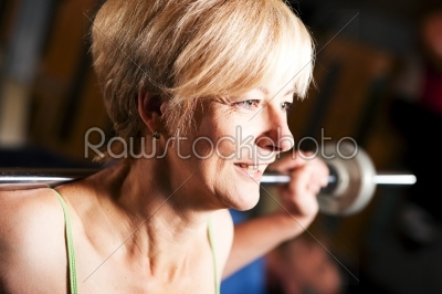 stock photo: mature woman lifting barbell-Raw Stock Photo ID: 50875