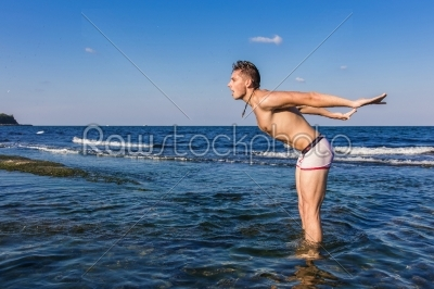 stock photo: naked young man coming out from the water-Raw Stock Photo ID: 67613