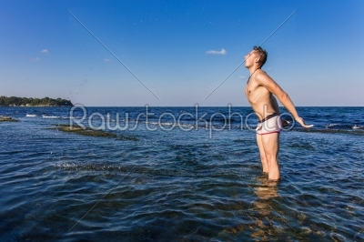 stock photo: naked young man coming out from the water-Raw Stock Photo ID: 67614