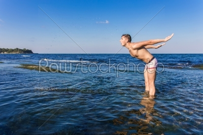 stock photo: naked young man coming out from the water-Raw Stock Photo ID: 67617