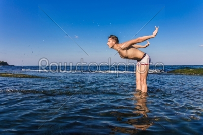 stock photo: naked young man coming out from the water-Raw Stock Photo ID: 67619
