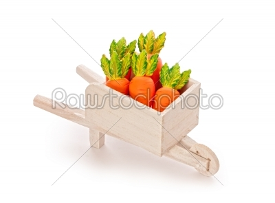 stock photo: orange toy carrot in a wooden shopping cart  with clipping path-Raw Stock Photo ID: 68226