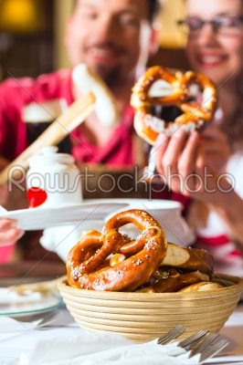 stock photo: people in bavarian tracht eating in restaurant or pub-Raw Stock Photo ID: 48852