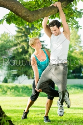 stock photo: people in city park doing chins or pull ups on tree-Raw Stock Photo ID: 49786