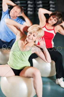 stock photo: people in gym on exercise ball-Raw Stock Photo ID: 50885