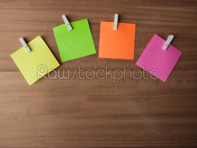 stock photo: post it notes on pegs on light wood-Raw Stock Photo ID: 75032