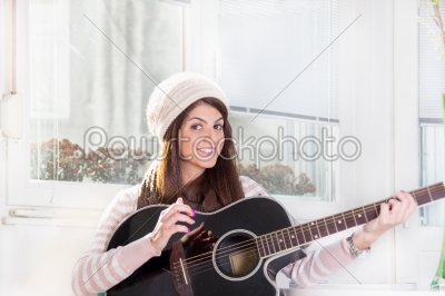 stock photo: pretty girl playing the guitar-Raw Stock Photo ID: 53997